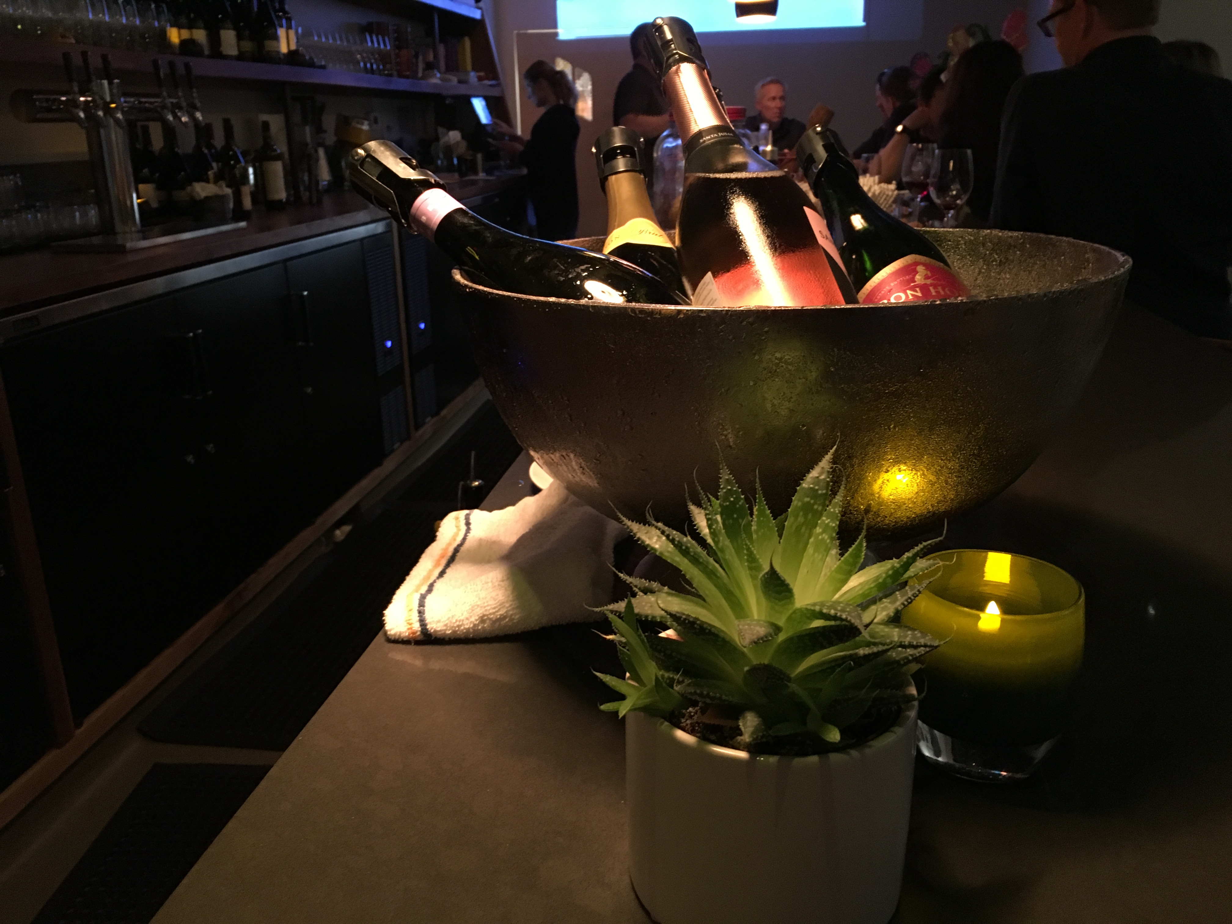 A photo of bottles of champagne, prosecco and sparkling rosé sit on the bar at the Honcho, a new hip local cocktail lounge in downtown Los Altos, California. Photo Courtesy of FoodWaterShoes