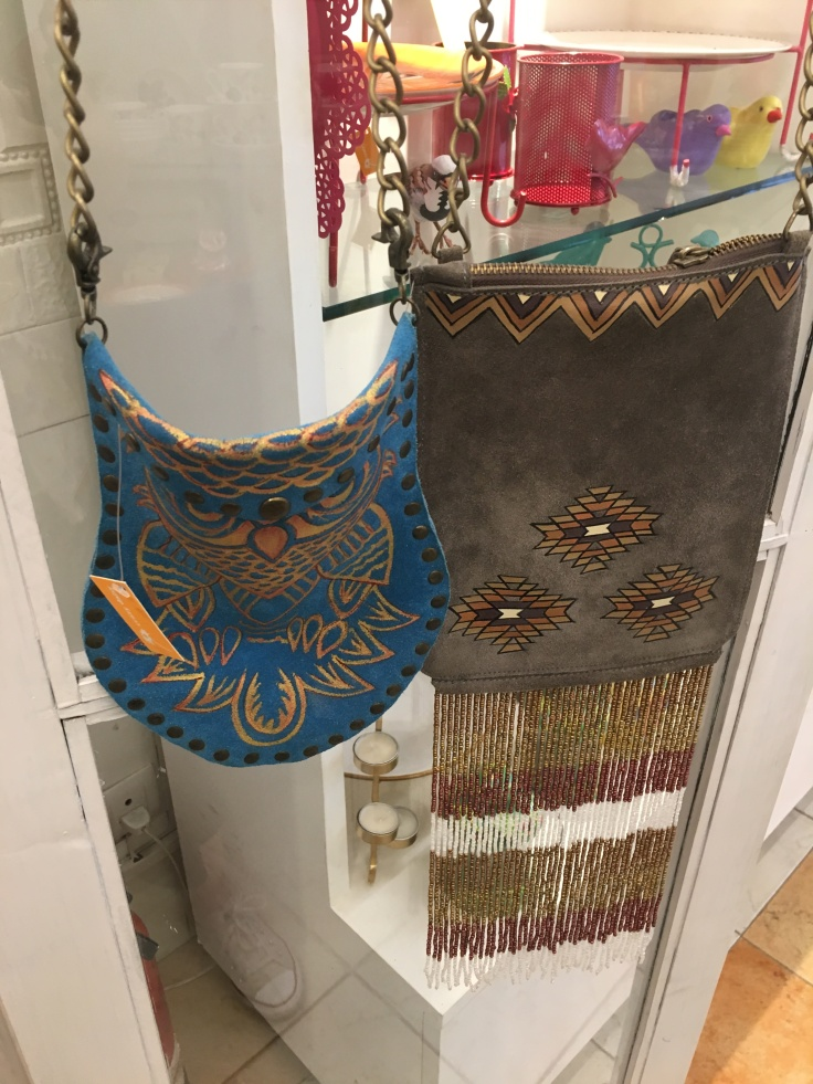 Beaded and Embellished Purses Hang from a Shelf at Crazy Daisy Boutique in New Delhi, India