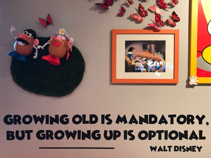 "At Scrambl'z in San Jose, California You'll See Cute Designs Like Mr. and Mrs. Potato Head Holding Hands and Quotes from Walt Disney that Say Things Like, ""Growing Old is Mandatory, But Growing Up is Optional."""