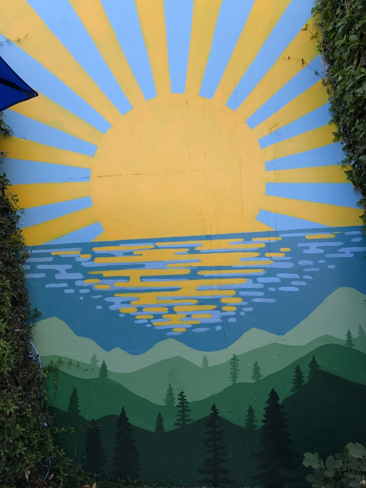 An Outdoor Sunshine Mural at Scrambl'z Restaurant in San Jose, California