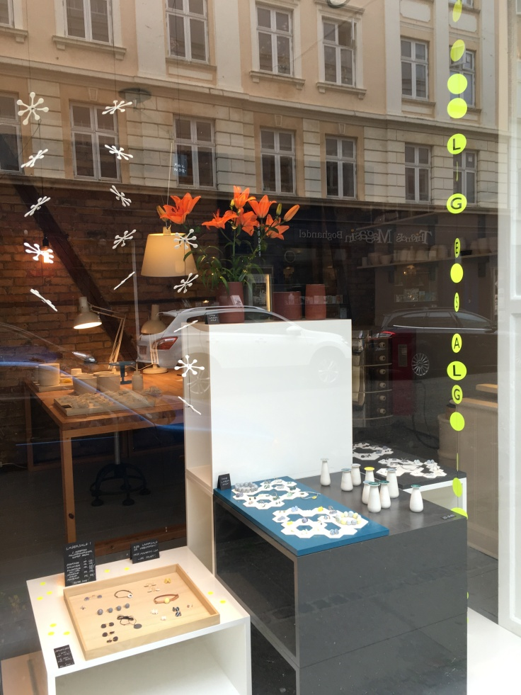 A Window Display at Priip in Copenhagen, Denmark Has Earrings and Little Vases on Display