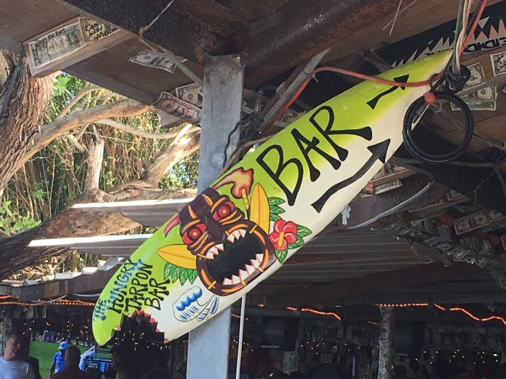 The Sign for The Hungry Tarpon Bar in Islamorada, Florida is a Surf Board with a Bite Out of it