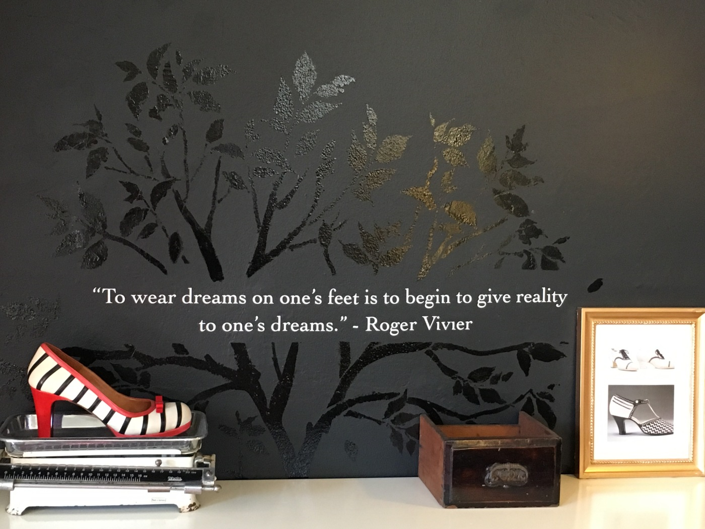"A Quote Written on a Black Wall that Says, ""To wear dreams on one's feet is to begin to give reality to one's dreams."" - Roger Vivier Quote at The Cook, His Wife and Her Shoes in the Surry Hills Suburb of Sydney, Australia"