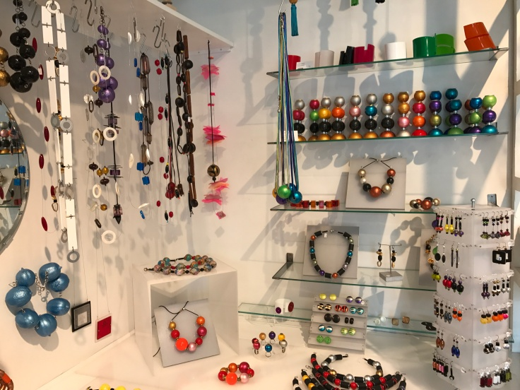 Accessories of Color - One of the Wall Displays Filled with Bracelets, Candlesticks, Earrings and Necklaces by Local Designers at ​Kirsuberjatréð in Reykjavík, Iceland