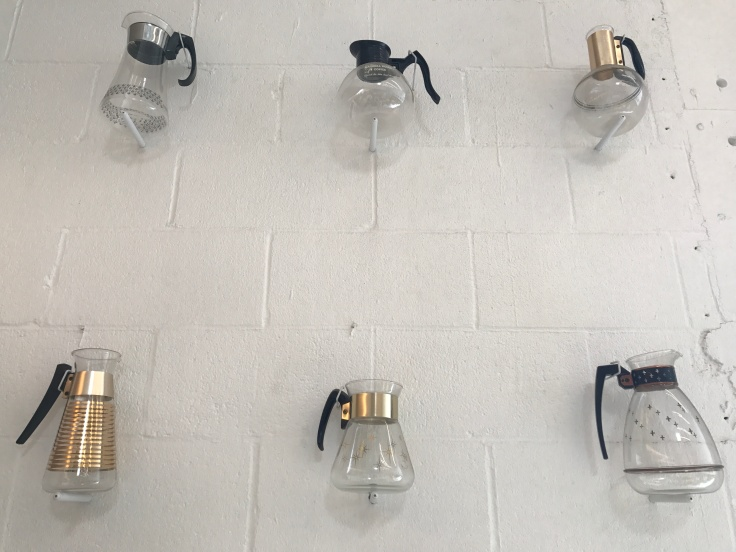 Retro Vintage Coffee Pots Hang on the Wall at Drip Line in Oakland, California