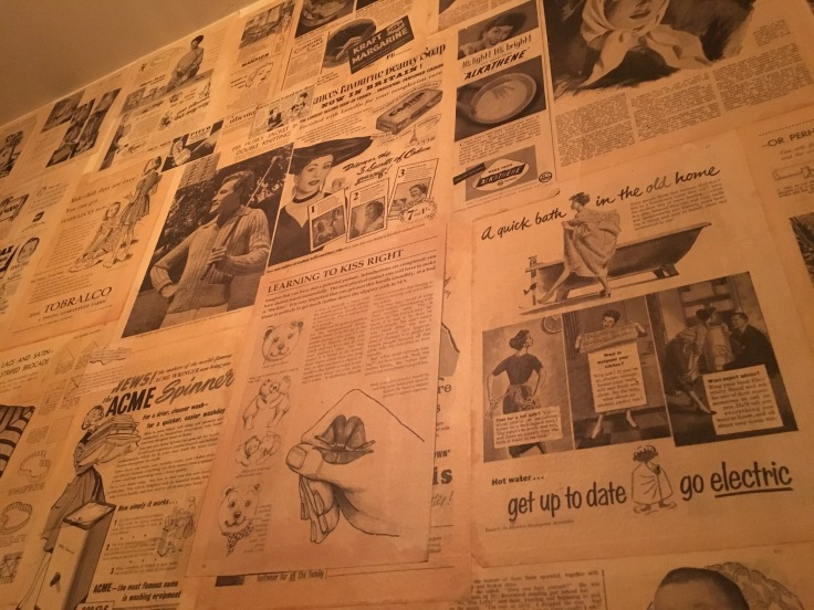 Kiss and Tell - Antique Print Ads and News Articles Decorate the Powder Room at The Chop Shop Food Merchants in Arrowtown, New Zealand