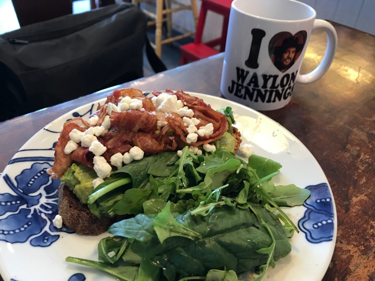 Bacon, Goat Cheese and Honey Avocado Toast on Zak the Baker Bread at Cream Parlor in Miami, Florida