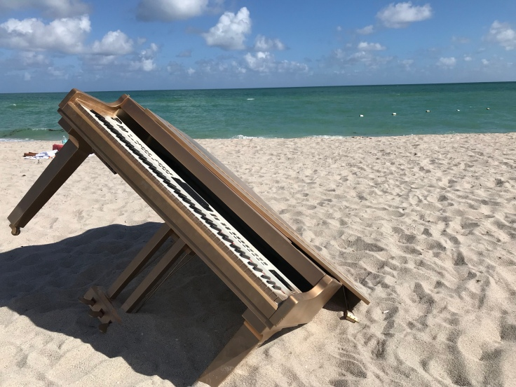 A Key Piece of Artwork - Tunney Transported Giant Pieces of the Taj Mahal Like This Gold Piano to Faena Beach in Miami, Florida