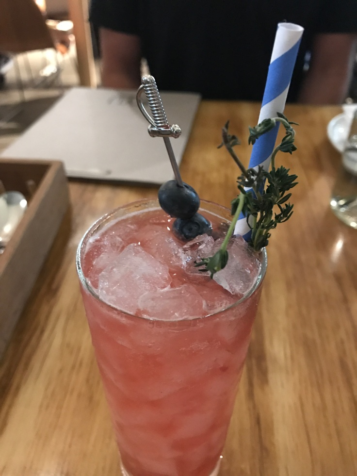 It's Cobblering Thyme - A Sweet Cocktail Made With Hendrick's Gin Plus House Made Blueberry Lemon Thyme Jam at KYU in Miami, Florida
