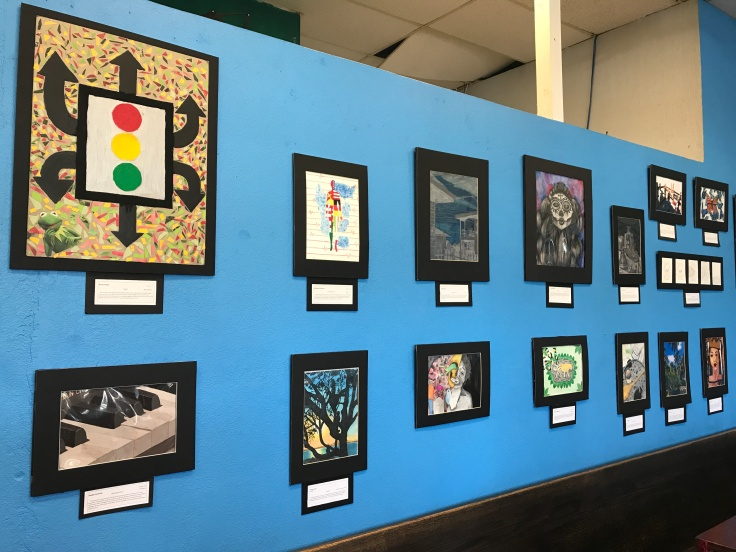 Artwork Designed by the Students of Saint Joseph Notre Dame High School Hangs on the Walls of the Blue Dot Café & Coffee Bar in Alameda, California