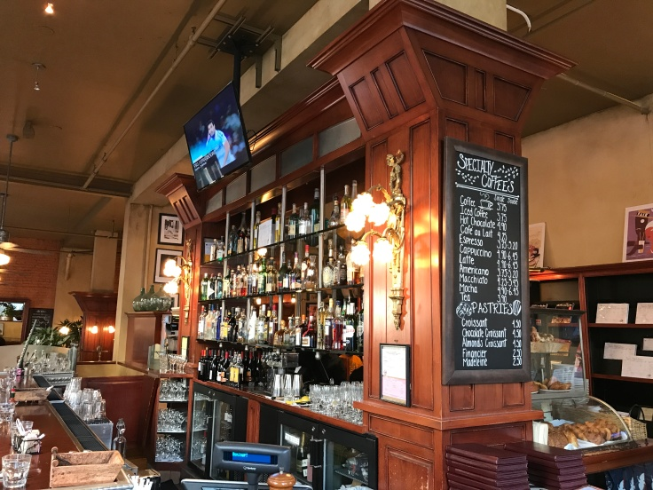 High Bar - One of the Highlights of Café de la Presse in San Francisco, California is its Stunning Alderwood Bar