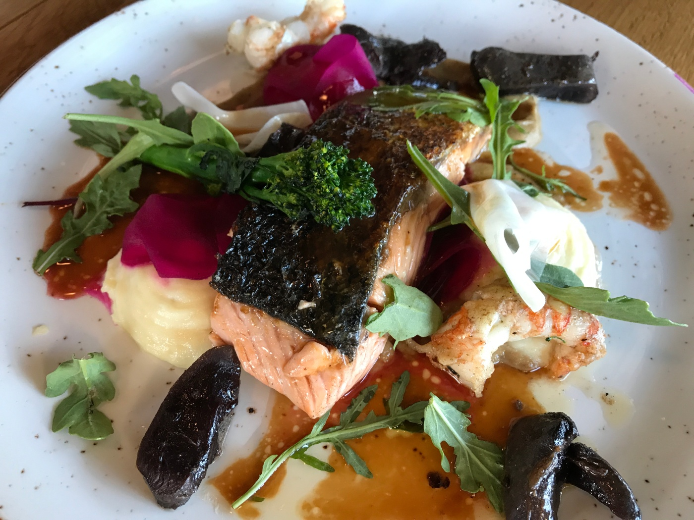 Salmon Served with Baked Asparagus, Icelandic Potatoes, Herb Salad and Yuzu Dressing at Strikið Restaurant in Akureyri, Iceland