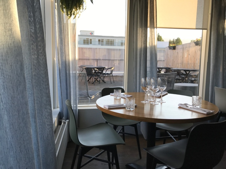 A Glance at the Interior Tables at Strikið in Akureyri, Iceland
