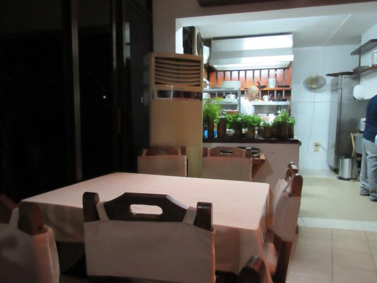 A Table With a Garden View Into the Kitchen at El Romero in Las Terrazas, Cuba