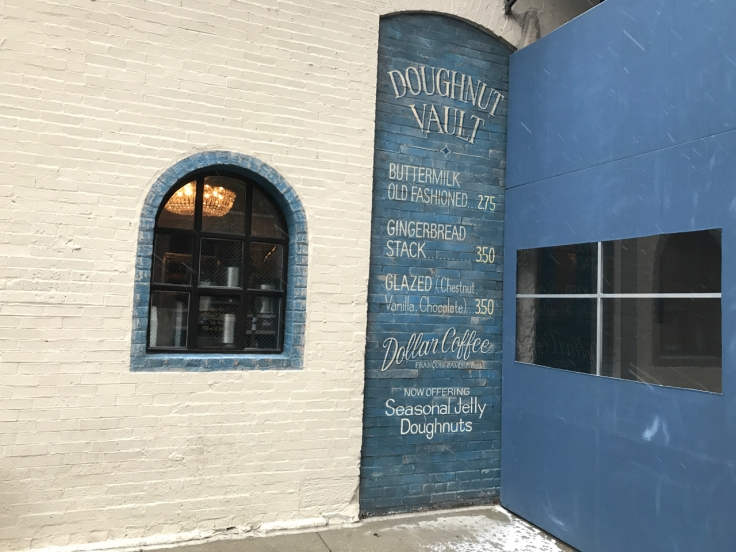 An exterior photo of the storefront of the Doughnut Vault in Chicago, Illinois taken from the street.