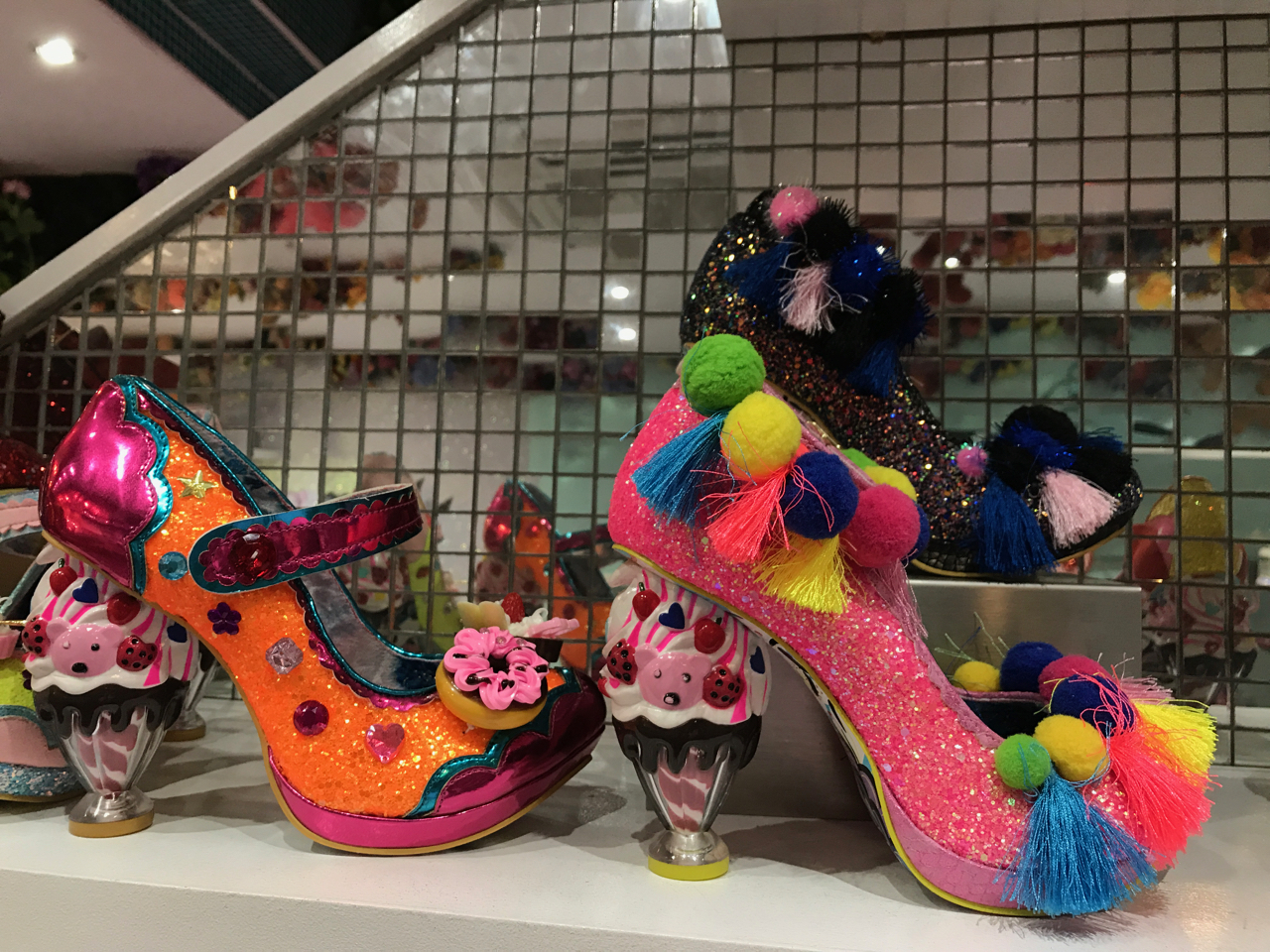 A photo of the arctic roll shoes from Irregular Choice in London, England. The shoes in this crazy high heel store feature glitter, ice cream sundaes as the heels, pompoms and tassels as well as donuts.