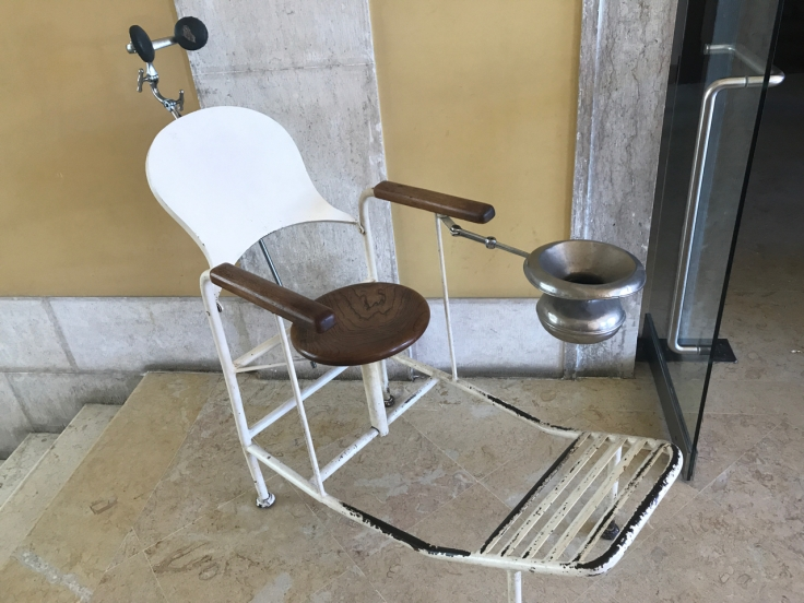 An antique examination chair on display at the pharmacy inspired restaurant called Pharmacia in Lisbon, Portugal.