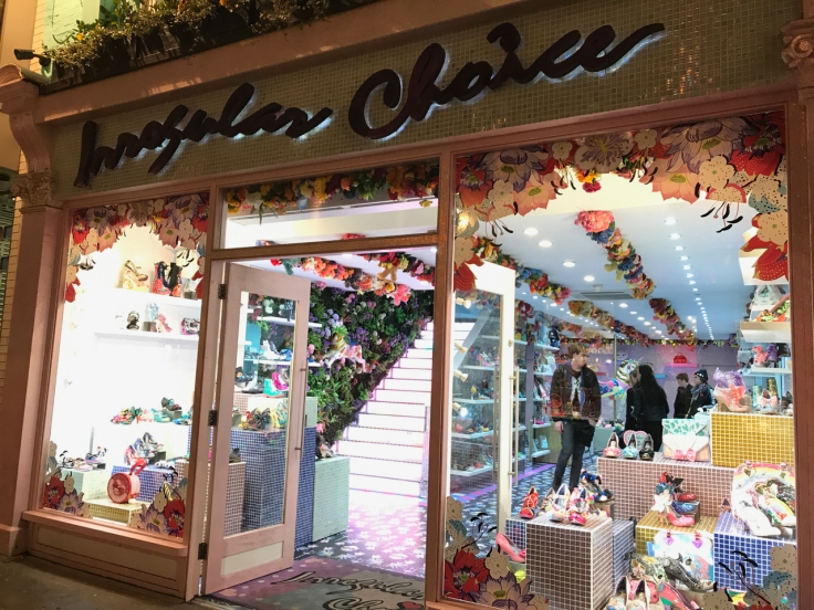 A street view photo of the outside of the Irregular Choice shoe store in London, England.