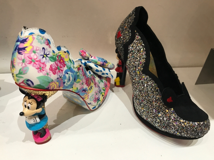 A photo of floral print shoes that feature a heel made out of Minnie Mouse on them at the Irregular Choice shoe store in London, England.