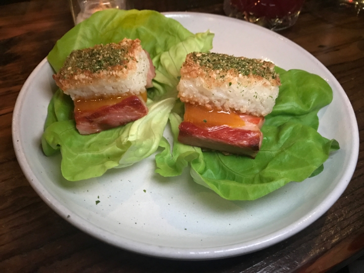 A photo of pork belly made with kimchi, koshihikari rice and bib lettuce at The Snug SF in San Francisco, California.