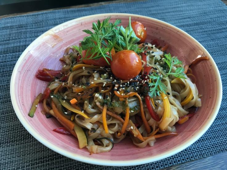 A photo of the rice and vegetable noodle wok (noodles de arroz e legumes wok) at Organic Caffe in Estoril, Portugal.