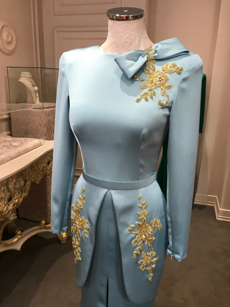 A baby blue silk dress with beautiful gold floral beadwork and embroidery. The gorgeous gown is on display at local fashion designer João Rôlo Couture's boutique in Lisbon, Portugal. Photo Courtesy of FoodWaterShoes