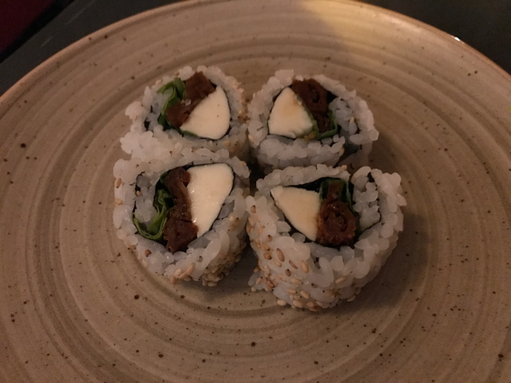 The caprese roll at Confraria Sushi in Cascais, Portugal is made with dried tomato (tomate seco), basil (rucula) and mozzarella. Photo Courtesy of FoodWaterShoes