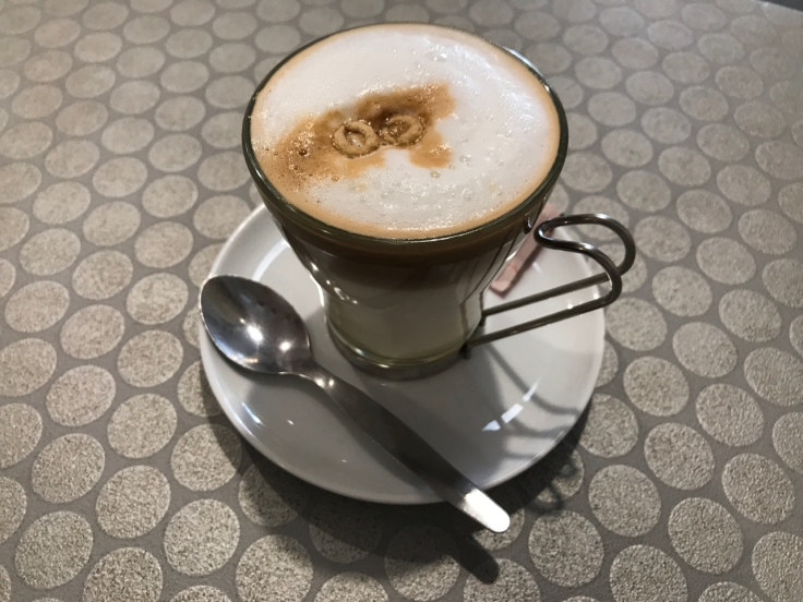 A cup filled with a café bombón at Pop Cereal Café in Porto, Portugal. The restaurant makes the tasty caffeine beverage by adding condensed milk to espresso.