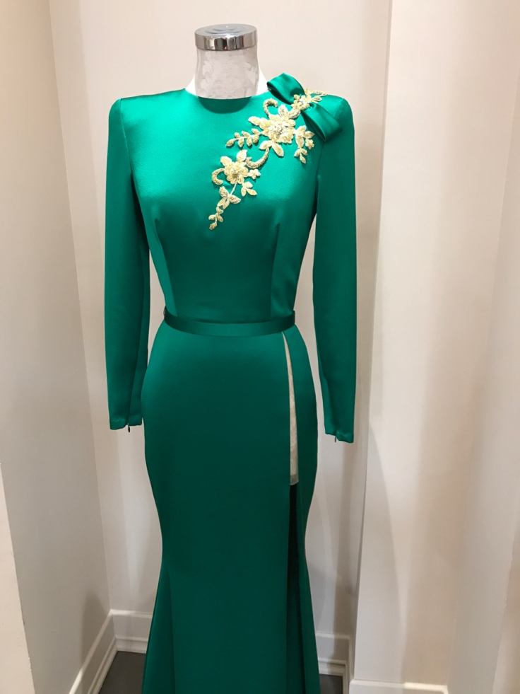 An emerald green gown with gold floral embroidery and beading. The silk high slit dress is on display at João Rôlo Couture (a haute local couture atelier boutique in Lisbon, Portugal). Photo Courtesy of FoodWaterShoes