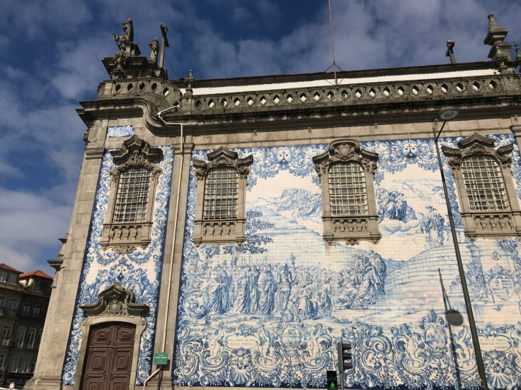 Beautiful blue and white azulejo tiles decorate the outside of Carmo Church (Igreja do Carmo) in Porto, Portugal. Photo Courtesy of FoodWaterShoes