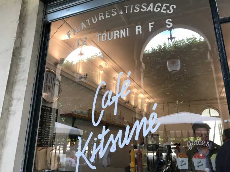An exterior street view photo of taken from the sidewalk outside the front of Café Kitsuné restaurant in Paris, France. Photo Courtesy of FoodWaterShoes