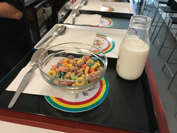 An old school cafeteria tray gets prepped with Kellogg's Froot Loops and a jug of milk at Pop Cereal Café in Porto, Portugal.