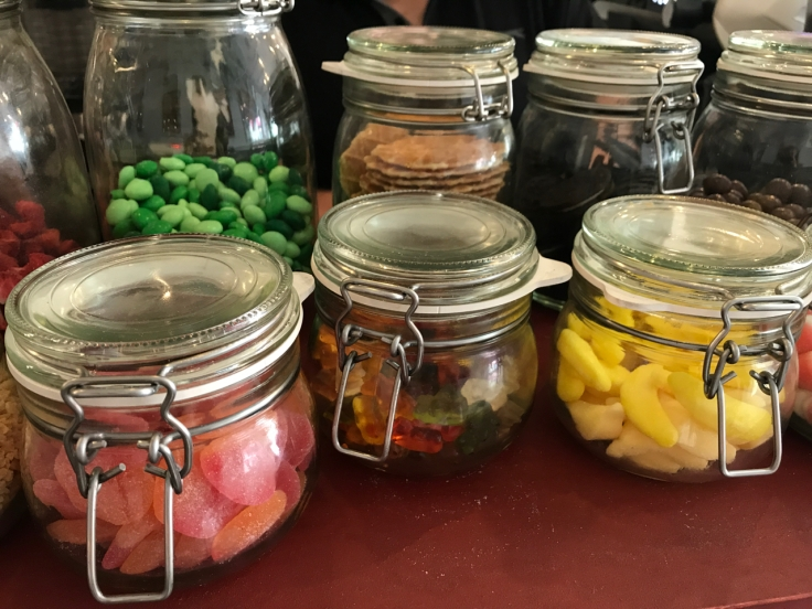 Glass jars filled with cereal toppings on display at Pop Cereal Café in Porto, Portugal. The restaurant offers everything from After Eight Mint M&M's to sour peaches and gummy bears.