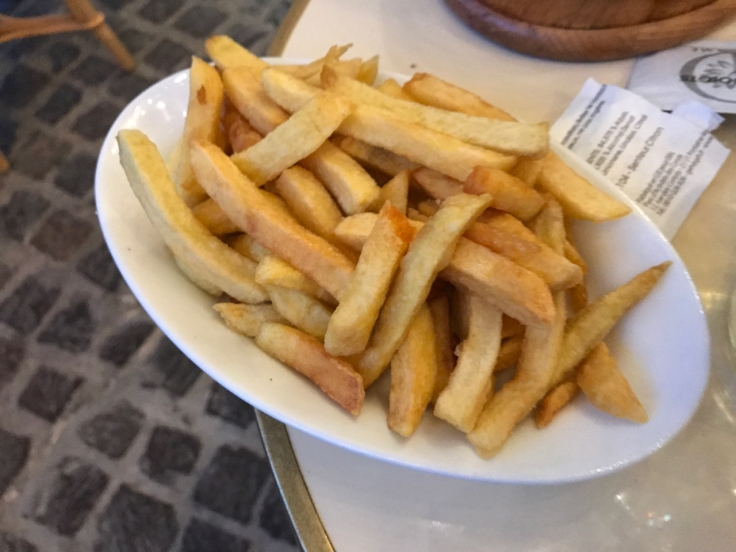 A plate of French fries (frites) at Au Pied de Cochon restaurant in Paris, France.