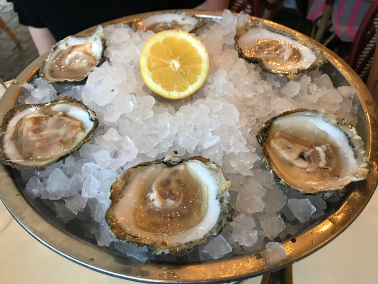 A plate of oysters (huîtres) at Au Pied de Cochon restaurant in Paris, France.