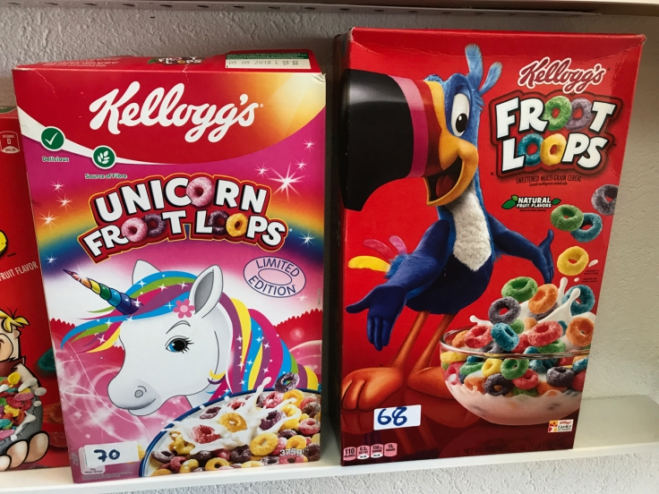 A photo of a box of Kellogg's Unicorn Froot Loops and Kellogg's Froot Loops at the Pop Cereal Café restaurant in Porto, Portugal.