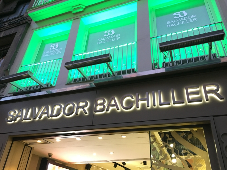 An exterior street view photo from the sidewalk outside of Salvador Bachiller's accessories shop and home of the SB Gastrobares including El Jardín de SB in Madrid, Spain. Photo Courtesy of FoodWaterShoes