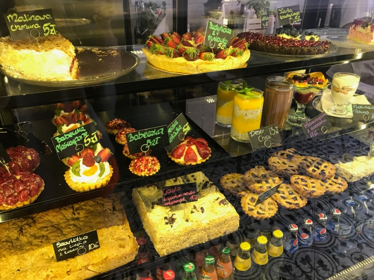 A display case at the Ciekawa Słodko-Słono restaurant shop in Tarnów, Poland is filled with Polish pastries, cakes, tarts , desserts and other delights.