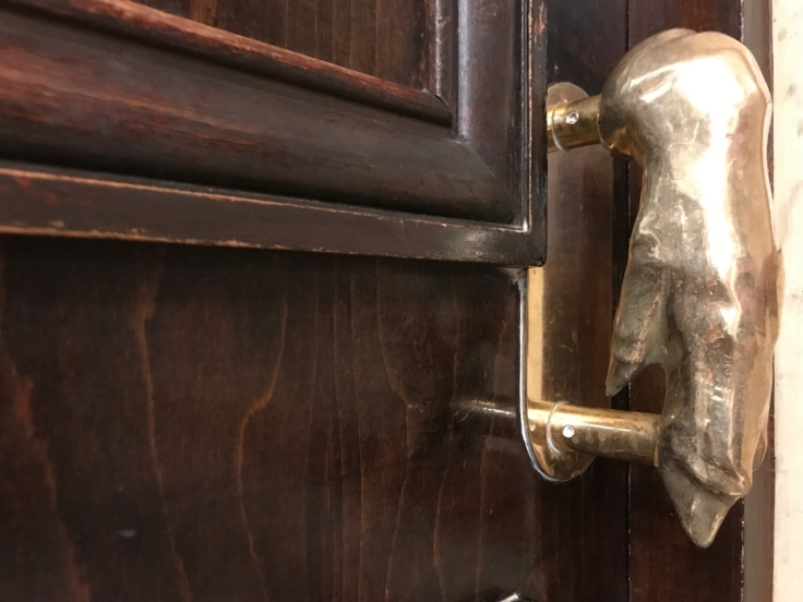 A pig's foot door handle at Au pied de Cochon restaurant in Paris, France.