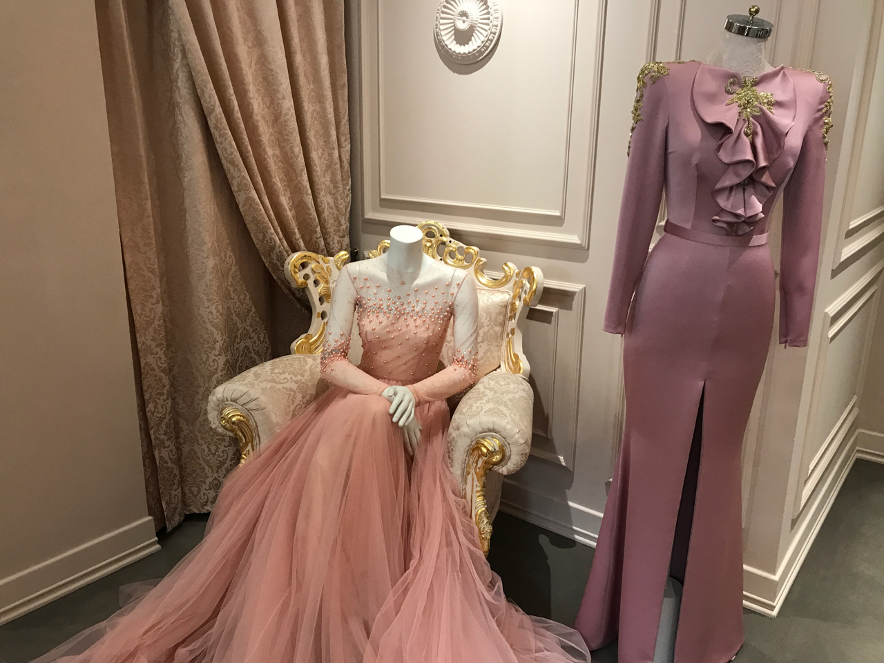 A pink beaded pearl princess tulle gown and a mauve silk dress as seen at the haute couture atelier João Rôlo Couture in Lisbon, Portugal. Photo Courtesy of FoodWaterShoes