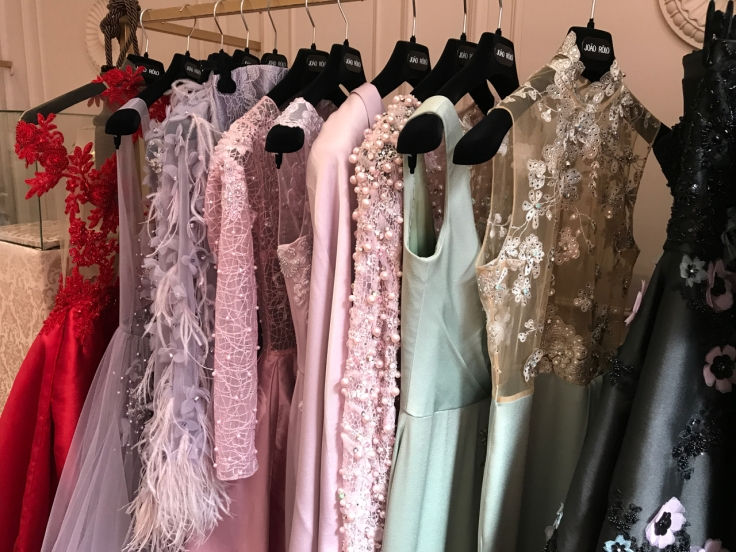 A rack of gorgeous gowns hang on display at local haute couture atelier João Rôlo Couture in Lisbon, Portugal. Photo Courtesy of FoodWaterShoes