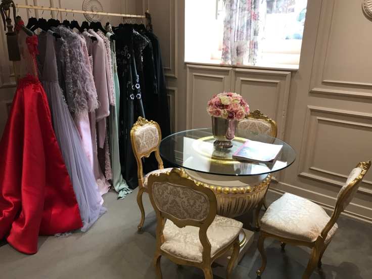 Gorgeous gowns hang on the rack in the front parlor at local fashion designer João Rôlo Couture's atelier in Lisbon, Portugal. Photo Courtesy of FoodWaterShoes