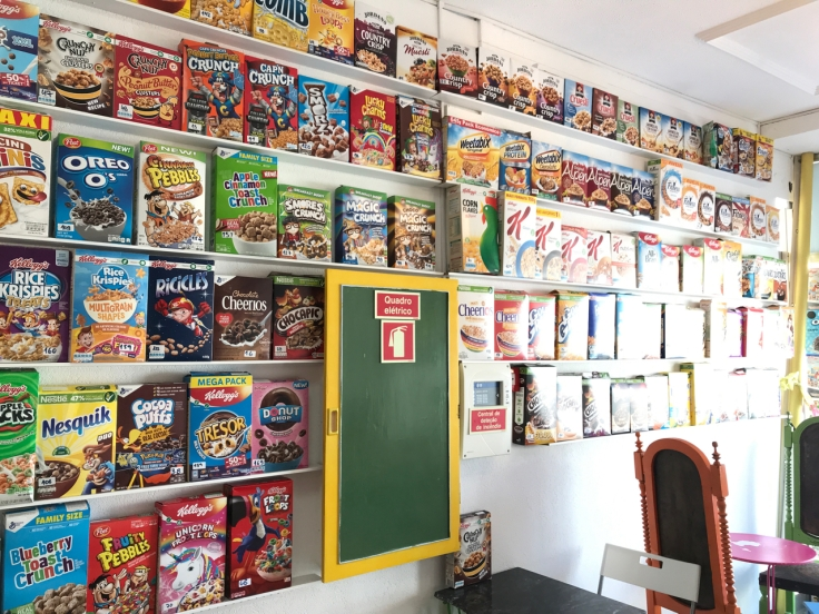 Dozens of boxes of cereal line the wall at Pop Cereal Café's quirky restaurant in Porto, Portugal.