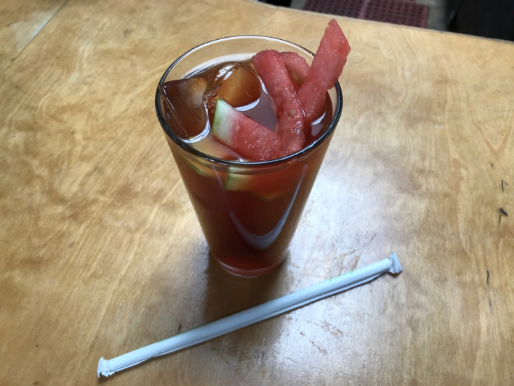 A glass of watermelon sweet tea filled with watermelon slices at Brenda's Meat & Three breakfast and brunch restaurant in San Francisco, California.