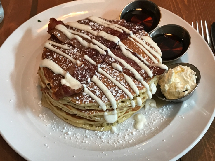 Bacon stuffed pancakes topped with even more bacon and sour cream drizzle at Mo's Breakfast + Burger Joint in Campbell, California. Photo Courtesy of FoodWaterShoes