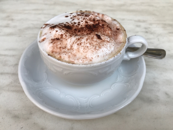 A cappuccino with a dusting of chocolate at Café Pouchkine in Paris, France. Photo Courtesy of FoodWaterShoes