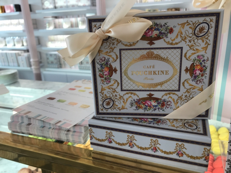Pretty boxes with flowers and bows sit on the counter at Café Pouchkine in Paris, France. Photo Courtesy of FoodWaterShoes