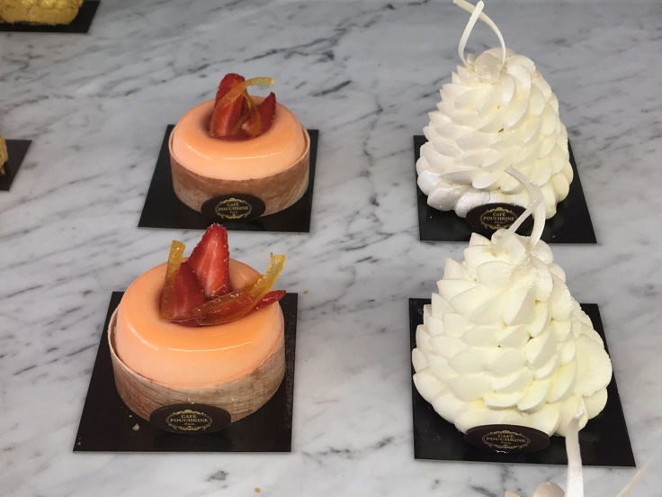 A peach colored vesna sits beside white puffs of pavlova at Cafeé Pouchkine in Paris, France. Photo Courtesy of FoodWaterShoes