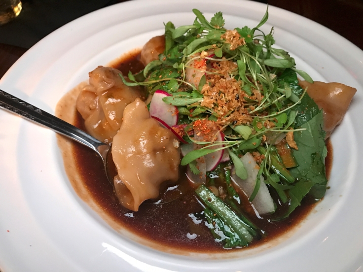 A photo of the pork belly dumplings at Shōjō, a local Asian restaurant in Boston, Massachusetts' downtown Chinatown. The dish features sake hoisin, jalapeños, radishes and cilantro. Photo Courtesy of FoodWaterShoes
