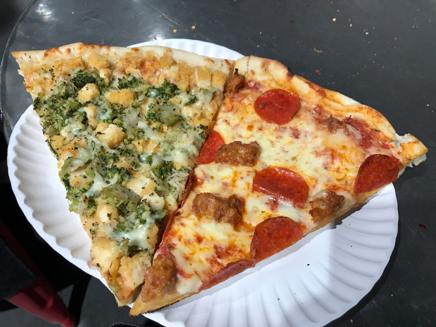 Slice Slice Baby - A Slice of Broccoli and Chicken Sits Beside a Slice of Pepperoni and Sausage at 2 Bros. Pizza in New York City, New York. Photo Courtesy of FoodWaterShoes.